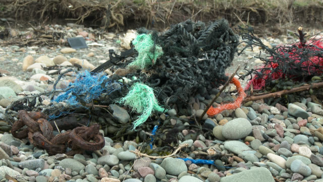 Fishing nets and debris washed up on a Scottish beach