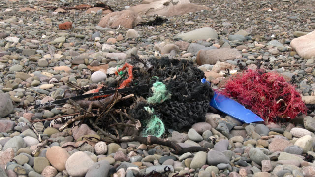 fishing nets and debris washed up on a scottish beach - dumfries and galloway stock videos & royalty-free footage