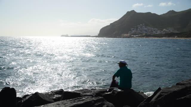 fishing on mountainous coastline of tenerife - rocky coastline stock videos & royalty-free footage
