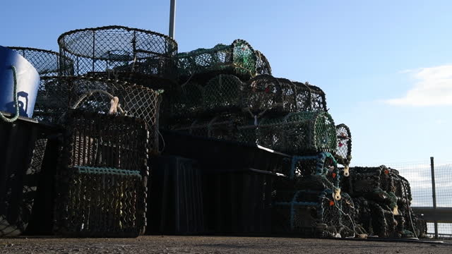 fishing pots on the island of jersey, united kingdom on saturday, may 8, 2021 following protests by french fishing vessels over fishing rights. - 男漁師点の映像素材/bロール