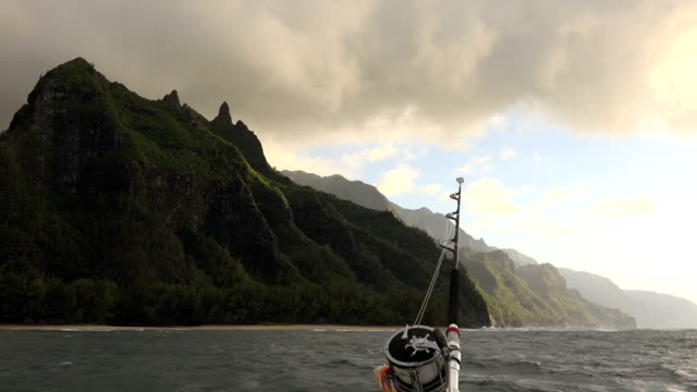 fishing rod in front of massive kauai island mountains - butte rocky outcrop stock videos & royalty-free footage