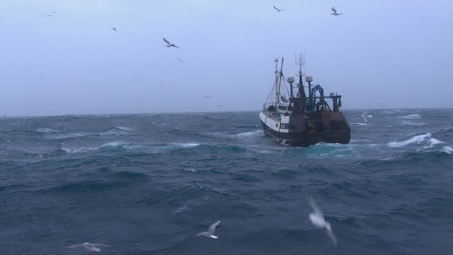 fishing trawler on rough atlantic ocean, scotland, uk - small boat stock videos & royalty-free footage