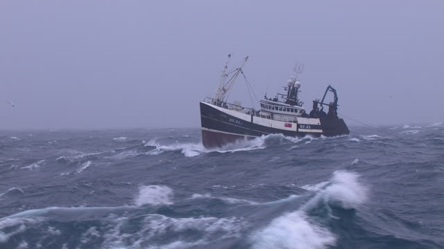 fishing trawler on rough atlantic ocean, scotland, uk - fishing stock videos & royalty-free footage