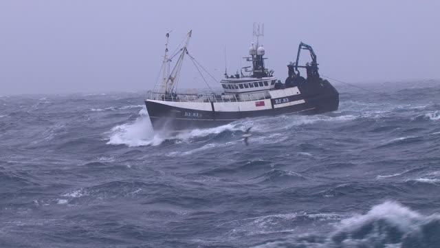 fishing trawler on rough atlantic ocean, scotland, uk - fishing boat stock videos & royalty-free footage