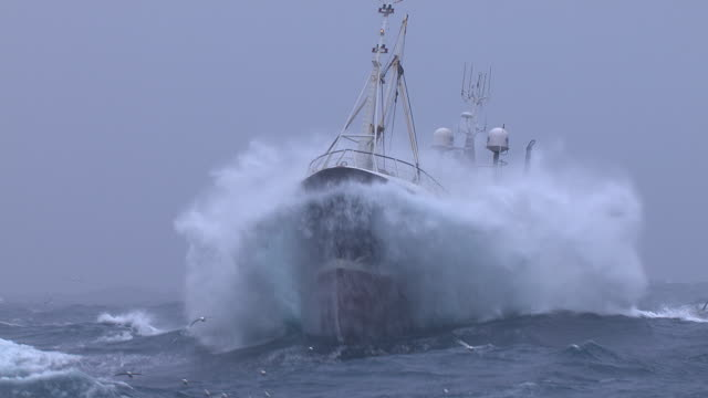 vídeos de stock, filmes e b-roll de fishing trawler on rough atlantic ocean, scotland, uk - rough