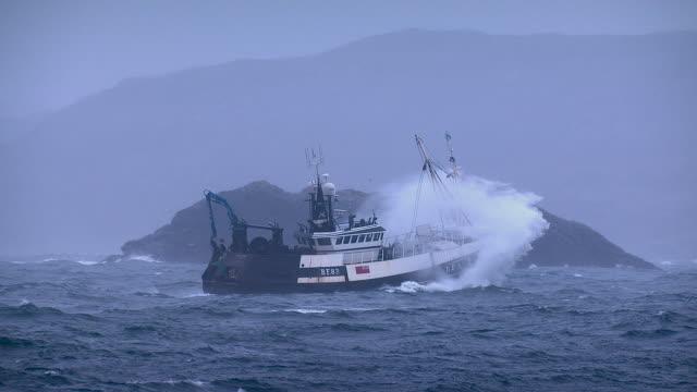 fishing trawler on rough atlantic ocean, scotland, uk - ship's bow stock videos & royalty-free footage