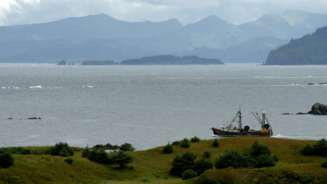 fishing trawler sails in gulf of alaska near kodiak - nautical vessel stock videos & royalty-free footage