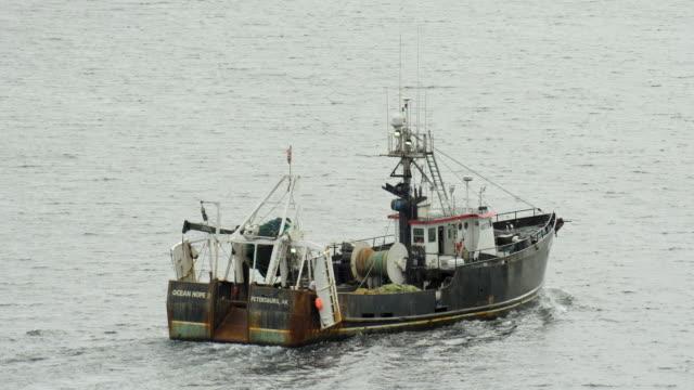 fishing trawler sails the waters of alaska near kodiak - fishing stock videos & royalty-free footage