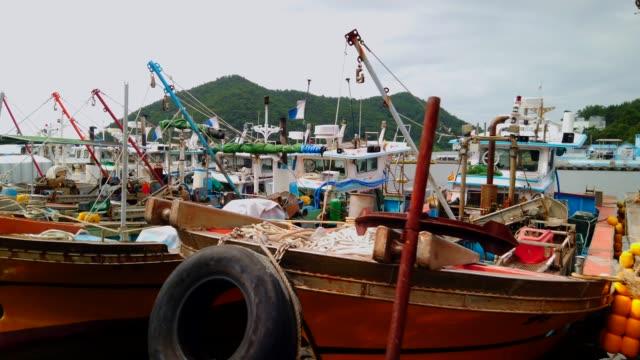 fishing vessels anchored in small harbor / south korea - anchored bildbanksvideor och videomaterial från bakom kulisserna