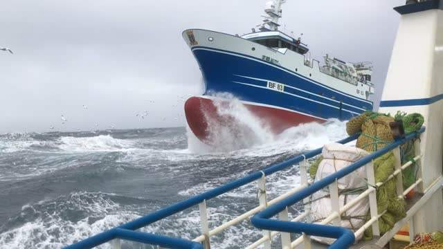 fishing vessels being tossed around in rough seas and massive waves on may 1, 2021 off the coast of scotland in the north atlantic. - large stock videos & royalty-free footage