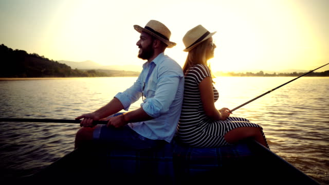 fishing with a loved one at sunset - romantic activity stock videos & royalty-free footage