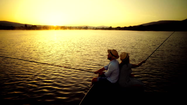 fishing with a loved one at sunset - loch stock videos and b-roll footage