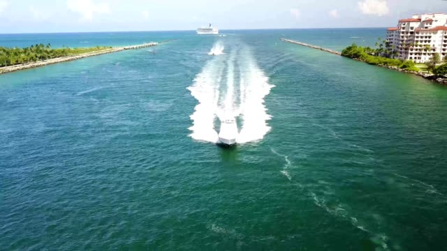Fishing yacht enters Government Cut Inlet in Miami Beach Florida