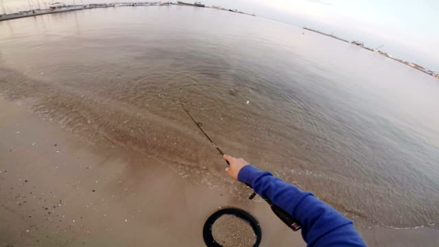 fishing-sea bass. slow motion. pov - fishing rod stock videos & royalty-free footage