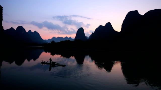 fishman in lijiang river - guilin stock videos & royalty-free footage