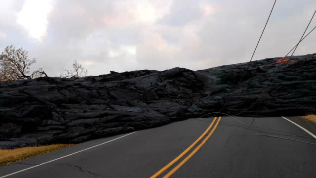 fissure 15 and 22 have significantly slowed since early morning today pausing pahoehoe lobes which were encroaching onto pgv's property one state of... - asphalt stock-videos und b-roll-filmmaterial