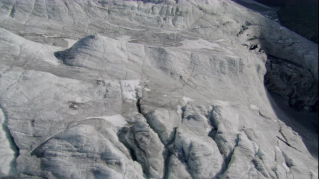 fissures criss-cross over the terminal edge of a glacier in the swiss alps. available in hd. - crisscross stock videos & royalty-free footage