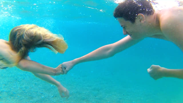 Fist bump underwater