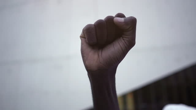 fist raised in the air in protest against racism. protests concept. symbol of anti racism protest. - fist stock videos & royalty-free footage