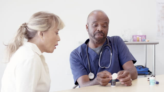 Fit 80 Year Old Woman Having Medical Check-Up With Her Ethnic Doctor