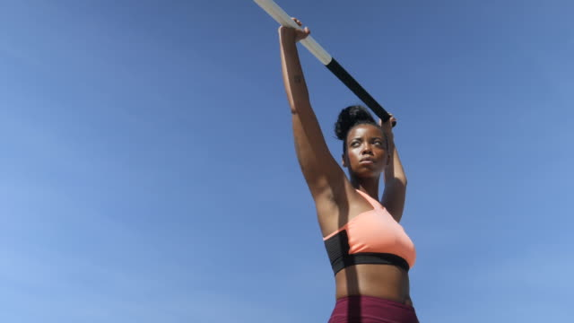 fit african american woman holds pole vault, close up - human limb stock videos & royalty-free footage