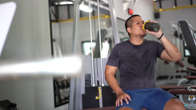 fit asian man drinking protein shake after workout for gain his nutrition for his body ans muscle - lap body area stock videos & royalty-free footage