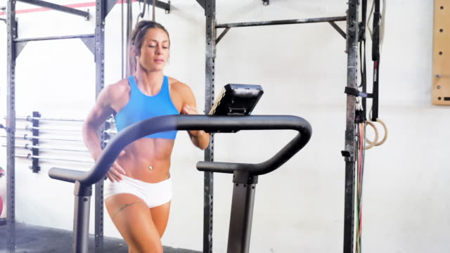 fit attractive woman running on treadmill. - running shorts stock videos & royalty-free footage