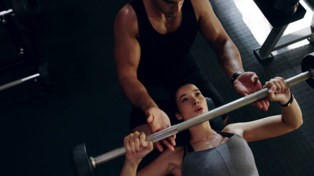 fit bodies take plenty of effort - bench press stock videos & royalty-free footage