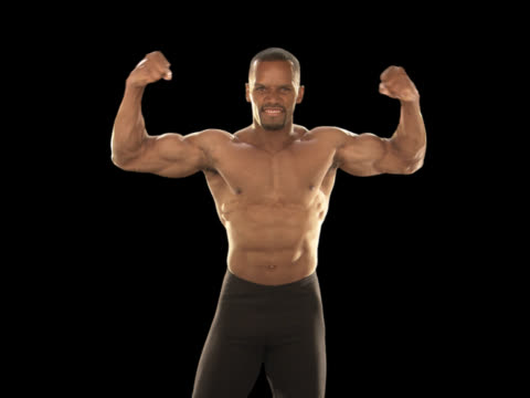 fit man flexing muscles - this clip has an embedded alpha-channel - pre matted stock videos & royalty-free footage