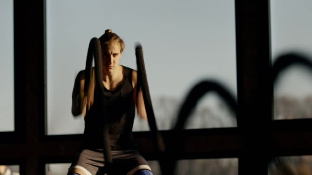 fit man has a strength training with ropes - self discipline stock videos & royalty-free footage