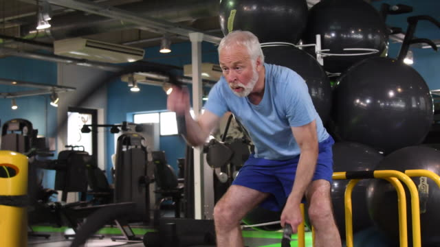 fit senior man using ropes to workout at gym - senior men stock videos & royalty-free footage