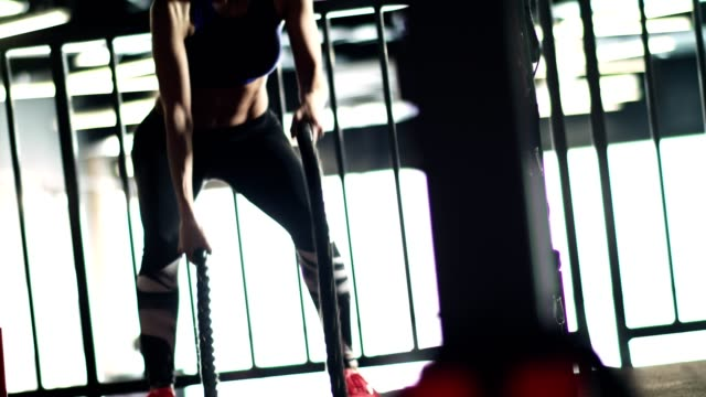 fit woman battling ropes in the gym - rope stock videos & royalty-free footage