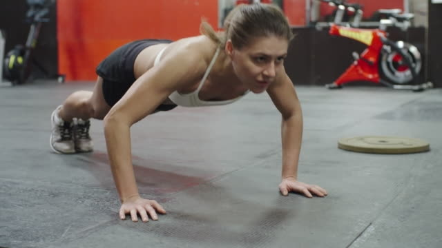 Fit woman doing push-up exercise