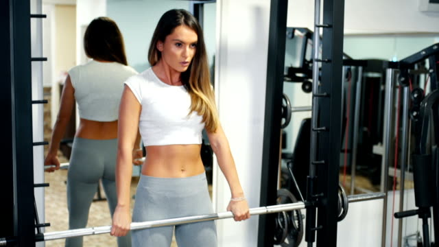 Fit woman in gym training