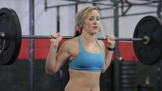 fit woman lifting weights - fatcamera stock videos and b-roll footage