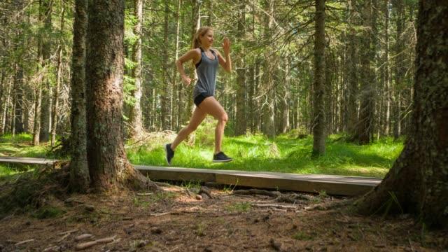 Fit woman runner jogging in nature