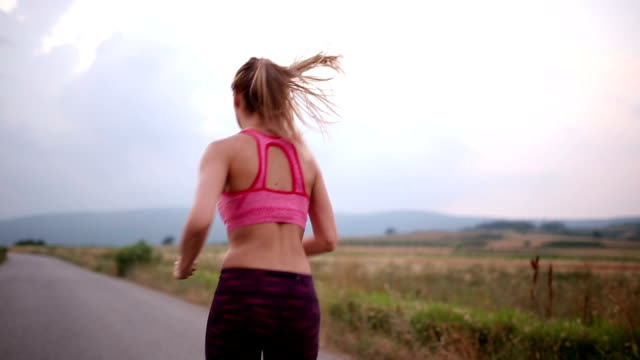 Fit woman running fast