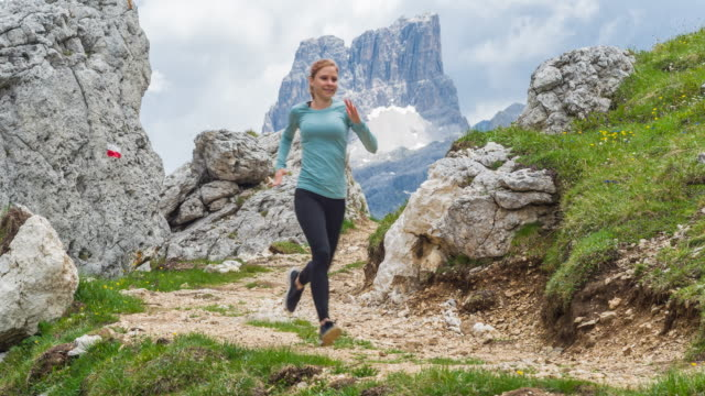 fit woman running off the beaten path and exploring the roads less traveled - trentino alto adige südtirol video stock e b–roll