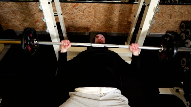 Fit young man exercising in the gym