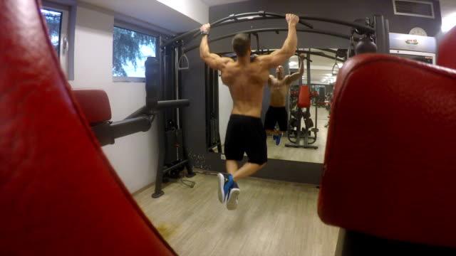 fit young man exercising - human limb stock videos & royalty-free footage
