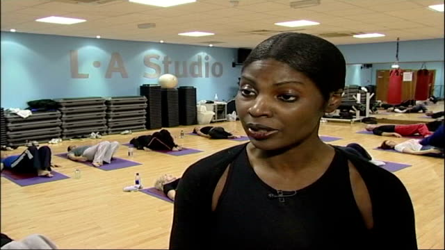 fitness campaigner's concern over unqualified instructors england london l a fitness club int dawn blake speaking to yoga students sot long shot of... - petition stock-videos und b-roll-filmmaterial
