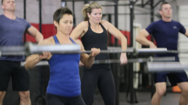 fitness class lifting weights - fatcamera stock videos and b-roll footage