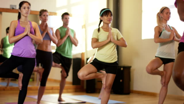 fitness class with multiethnic students doing yoga and warming up - exercise class stock videos & royalty-free footage