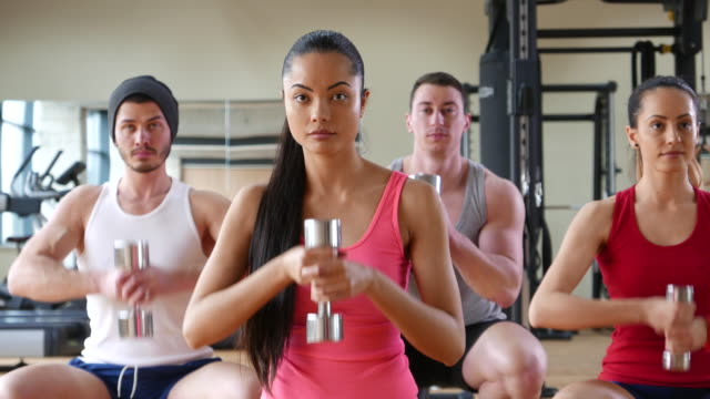 Fitness class workout with dumbbells