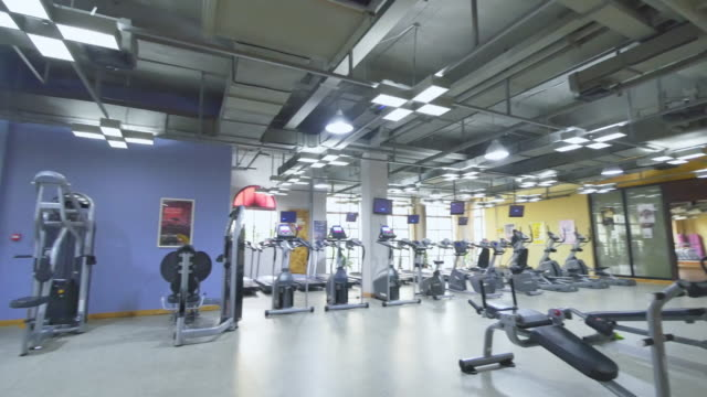 fitness equipment in modern gym - health club stock videos & royalty-free footage