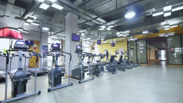 fitness equipment in modern gym - sports hall stock videos & royalty-free footage