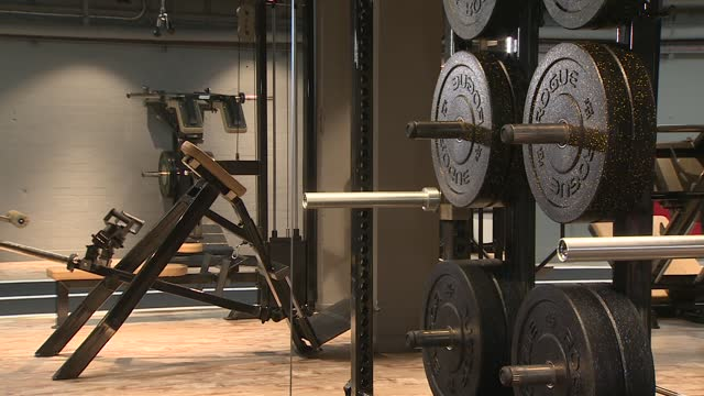 gym gvs; england: int various shots of empty gym including dumbbells on weight racks, gym machines, weight plates on racks and barbells / - weight stock videos & royalty-free footage