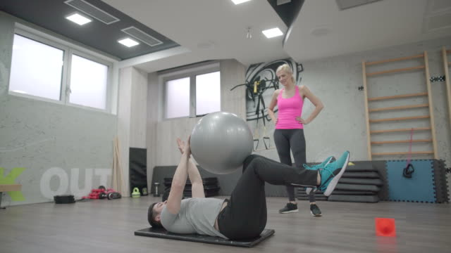 fitness instructions - fitness ball stock videos & royalty-free footage