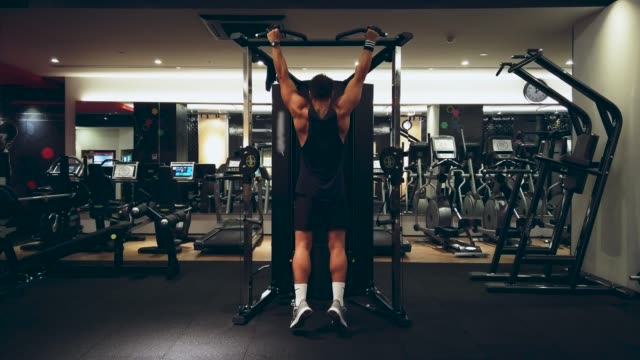 fitness instructor working out, chin-ups bodyweight exercise in health club - pull ups stock videos & royalty-free footage