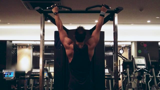 fitness instructor working out, chin-ups bodyweight exercise in health club - hand weight stock videos & royalty-free footage